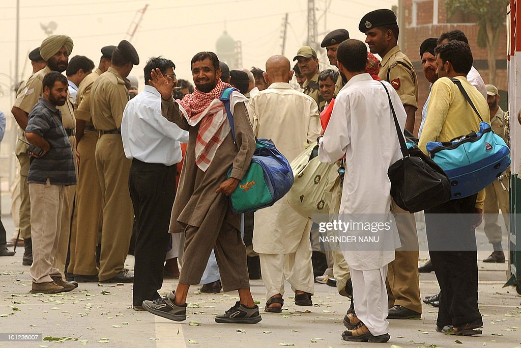 Released Pakistani prisoners wave as they cross over to Pakistan at the international India-Pakistan Wagah Border in India's northwestern state of Punjab on May 28, 2010. In a goodwill gesture and to boost the peace process with Pakistan, the Indian government released 25 Pakistani nationals to Pakistan.