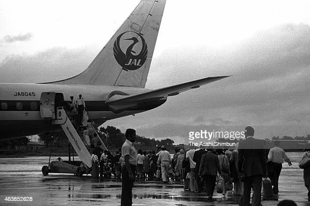 Released passengers get on a special aircraft prepared by the Japanese government at Dhaka Airport on October 3 1977 in Dhaka Bangladesh Five members...