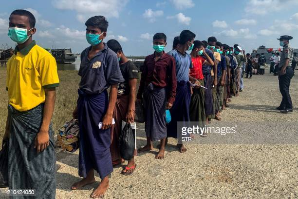 Released Rohingya prisoners wearing face masks amid concerns of the COVID19 coronavirus pandemic arrive in Sittwe jetty in Rakhine State after being...