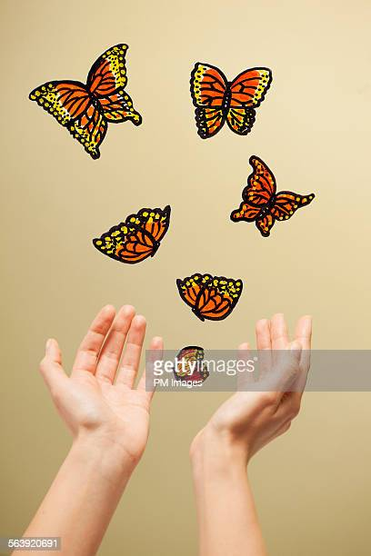 releasing illustrated butterflies - mixed media stock pictures, royalty-free photos & images