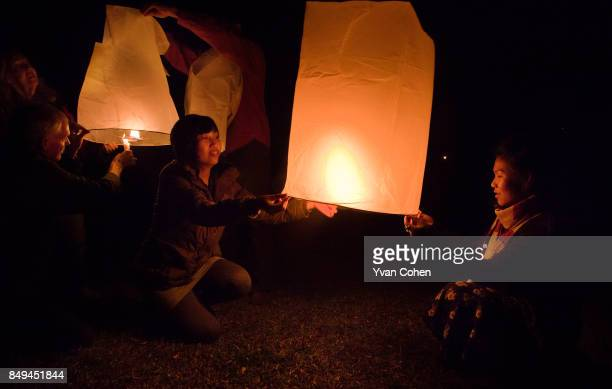 Releasing traditional Yi Peng lanterns in Sop Moei in northwest Thailand close to the Burmese border