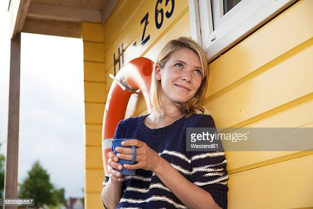 releaxed woman on a house boat with coffee cup - houseboat stock pictures, royalty-free photos & images