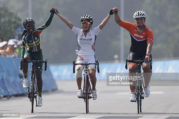 Relebohile Annastacia Pebane of South Africa Domenica Michelle Azuero Gonzalez of Ecuador and Viviana van Hees of Netherlands ride in the Women's...
