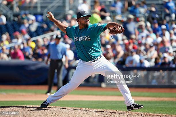 Releif pitcher Joaquin Benoit of the Seattle Mariners pitches against the Chicago Cubs during the spring training game at Peoria Stadium on March 10...
