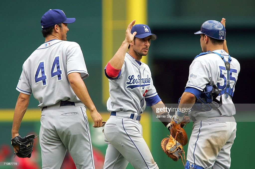 Releif pitcher Takashi Saito #44 of the Los Angeles Dodgers is congratulated by catcher Russell Martin #55 and Nomar Garciaparra #5 after defeating the Washington Nationals on May 27, 2006 at RFK Stadium in Washington, DC. The Dodgers defeated the Nationals 3-1.