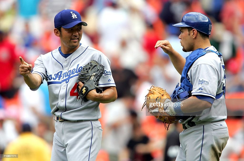 Releif pitcher Takashi Saito #44 of the Los Angeles Dodgers is congratulated by catcher Russell Martin #55 after defeating the Washington Nationals on May 27, 2006 at RFK Stadium in Washington, DC. The Dodgers defeated the Nationals 3-1.