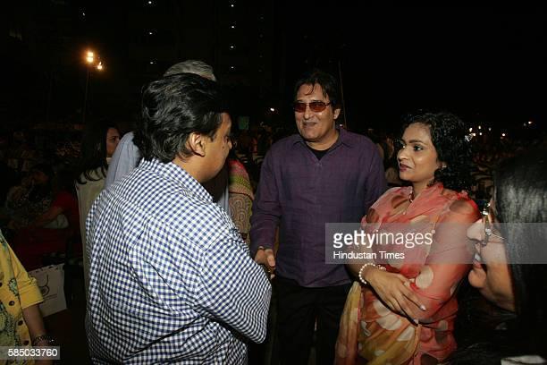 Reliance Industries Limited chairman Mukesh Ambani greets Vinod Khanna with Kavita Khanna