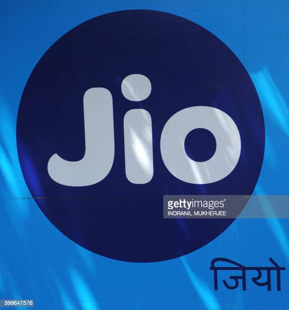 A Reliance Jio Infocomm 4G mobile services logo is seen outside a shop in Mumbai on September 6 2016 India's richest man Mukesh Ambani announced last...