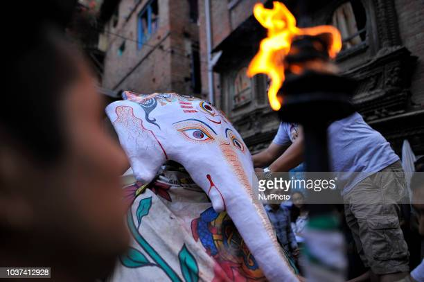 Masked dancers aranging to perform ritual triditional dance on the first day of Indra Jatra Festival celebrated in Basantapur Durbar Square Kathmandu...