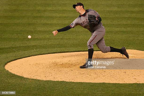 Reliec pitcher Brad Ziegler of the Arizona Diamondbacks delivers to home plate during the ninth inning against the Colorado Rockies at Coors Field on...