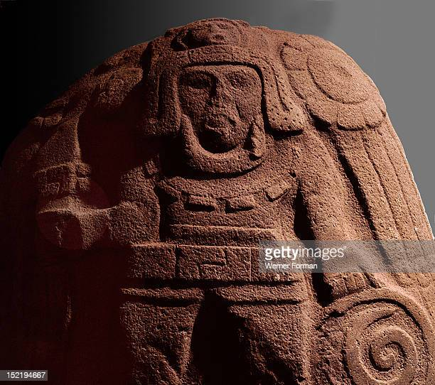 Relief carving representing a warrior with shield and war bonnet Mexico Olmec