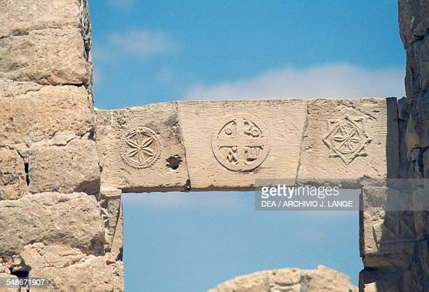 Relief depicting a cross on a architrave in the Northern Church Byzantine period ancient Nabataean city of Shivta on the Incense Route Negev Desert...