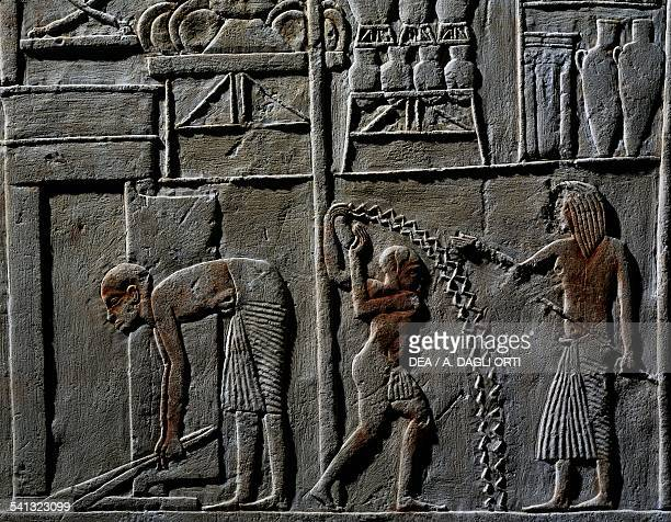 Relief depicting a Pavilion for highranking officer or commander in chief a servant sweeping the floor two characters sprinkling water possibly a...