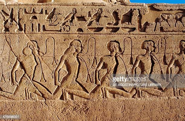 Relief depicting coloured and Asian prisoners from the Battle of Kadesh detail from the base of the thrones on the facade of the Great Temple of...