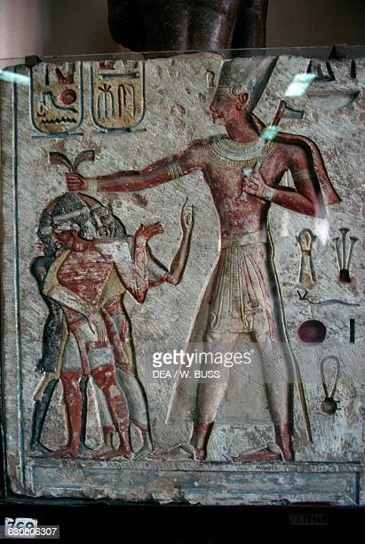 Relief depicting Ramesses II subduing the enemies by pulling their hair 12901224 BC Egypt Egyptian civilisation New Kingdom Dynasty XIX Cairo...