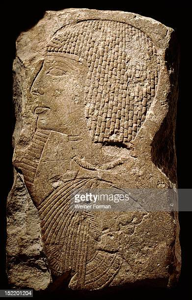Relief depicting Ramesses II with a bound Nubian captive Text in cartouche reading Lord of the Two Lands User maat ra setep n ra Lord of the...