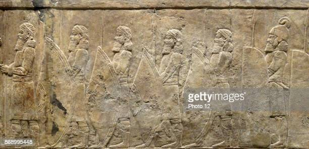 Relief depicting The royal lion hunt. Assyrian, about 645-635 BC From Nineveh, North Palace. Grooms lead horses towards a screened enclosure, within...