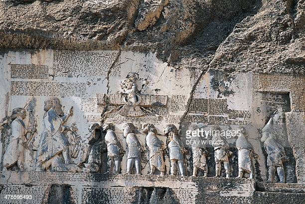 Relief depicting the victory of Darius I over magus Gaumata with inscriptions in three languages ancient Persian Elamite and Babylonian Bisotun Iran...