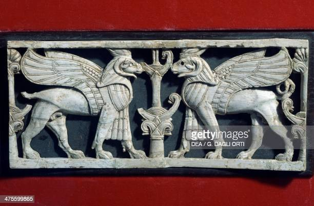 Relief depicting two sphinxes with ram heads facing each other an ornamental frieze offered by the Aramaic king Hazael to the king of Assyria ivory...