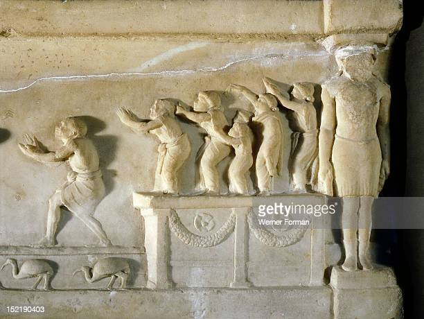 A relief found at Ariccia south of Rome which illustrates the celebration of religious rites in Egypt Detail shows worshippers on a platform...