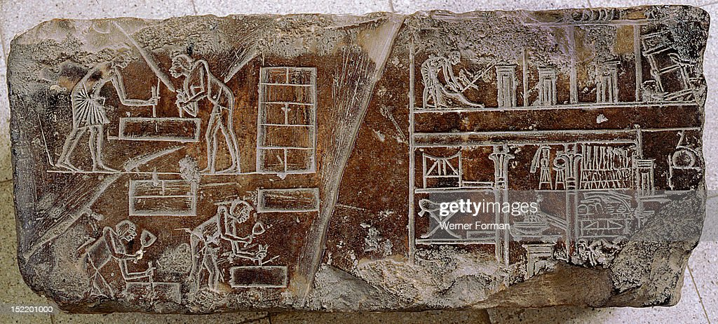 A relief fragment with a representation of stonemasons and other craftsmen at work and a cross section of a house : News Photo