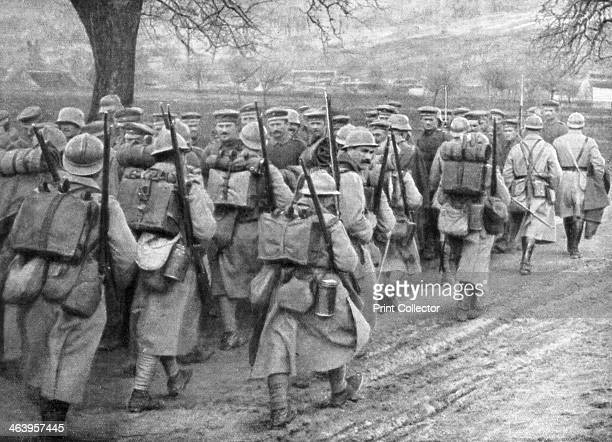 Relief French infantry passing a line of prisoners PlessisdeRoye Picardy France 30 March 1918