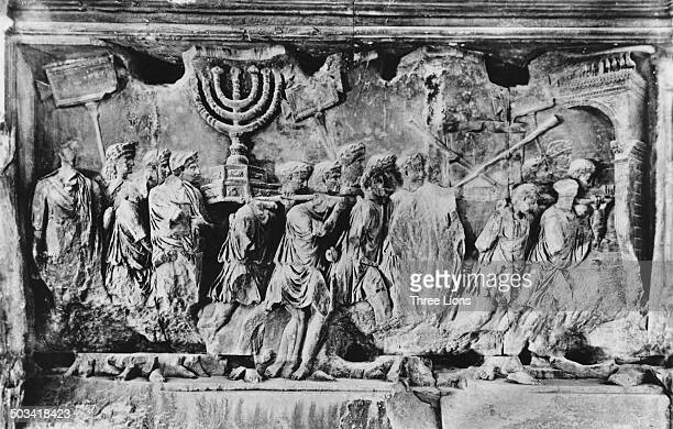 A relief from the Arch of Titus in Rome Italy photographed circa 1955 The carving depicts spoils including the Menorah and the trumpets of Jericho...