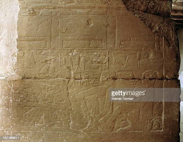 A relief from the mastaba of Niankhkhnum and Khnumhotep priests and overseers of the palace manicurists of King Neweserra The scene could depict a...