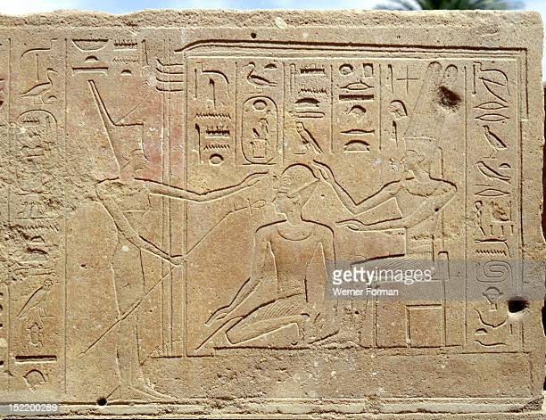 Relief from the Red Chapel of Hatshepsut She appears wearing the blue crown between the enthroned Amun and his standing consort Amunet Egypt Ancient...