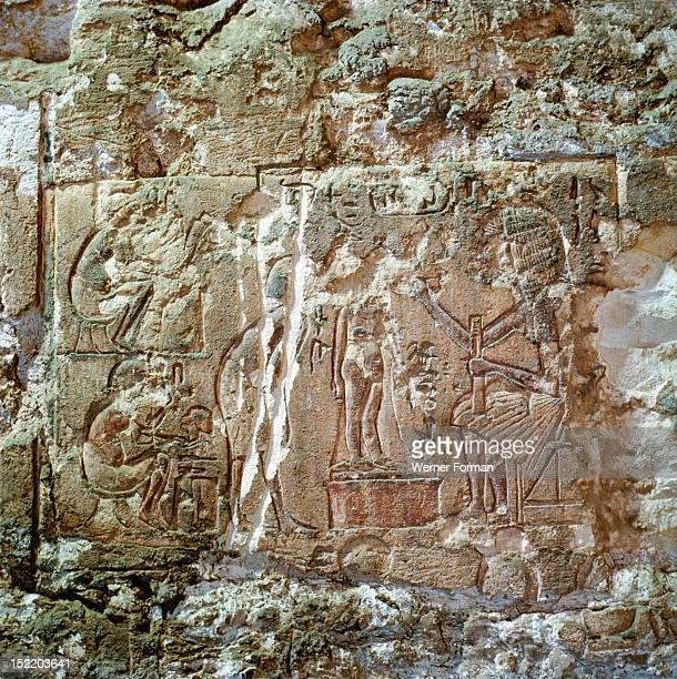 Relief from the tomb of Huye The chief sculptor Yuti paints the statue of Princess Beketaten daughter of Nefertiti and Akhenaten Egypt Ancient...