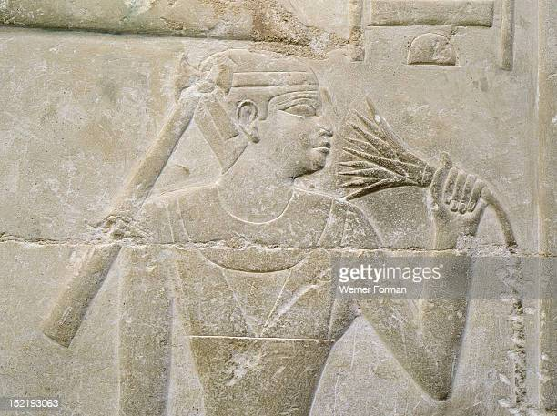 A relief in the tomb of Mereruka depicting a person sniffing a lotus blossom Egypt Ancient Egyptian 6th dynasty c 2345 2323 BC Saqqara