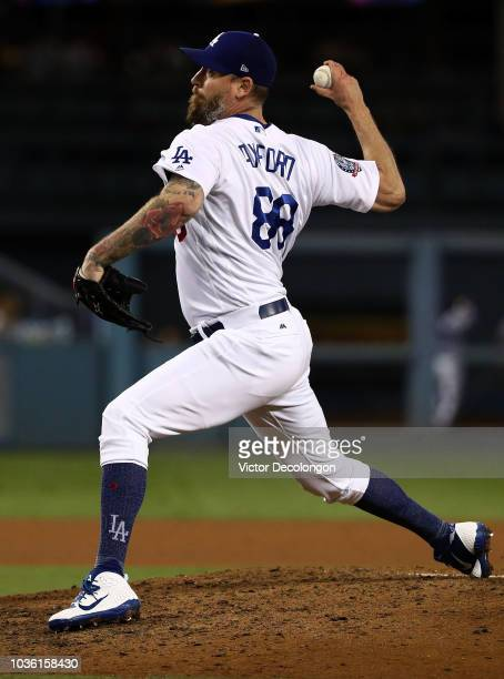 Relief John Axford of the Los Angeles Dodgers pitches during the eighth inning during the MLB game against the Colorado Rockies at Dodger Stadium on...