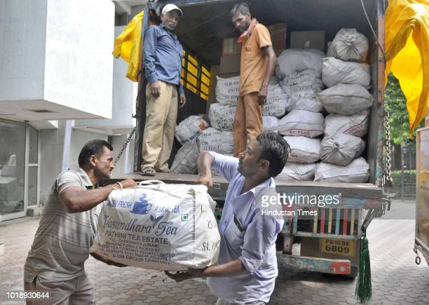 Relief material being loaded in a truck for Kerala flood victims at Guru Nanak Stadium on August 18 2018 in Ludhiana India