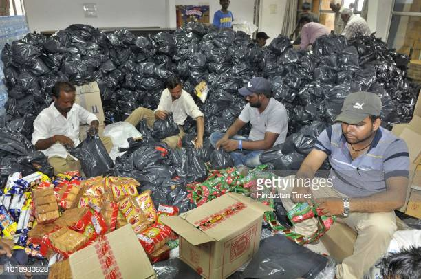 Relief material being packed for Kerala flood victims at Guru Nanak Stadium on August 18 2018 in Ludhiana India