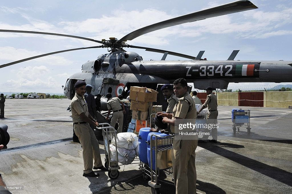 Relief material for those stranded in disaster affected areas being loaded in a helicopter at the Jolly Grant airport on June 26, 2013 in Dehradun, India. Some 1,000 people mostly the pilgrims to Badrinath and Kedarnath have died in flash floods and landslides caused by heavy downpours on June 16.