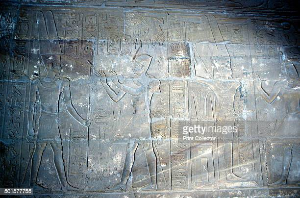 Relief of Alexander the Great as the Pharaoh before the god AmunRa Temple sacred to Amun Mut and Khons Luxor Egypt Alexander is identified by his...