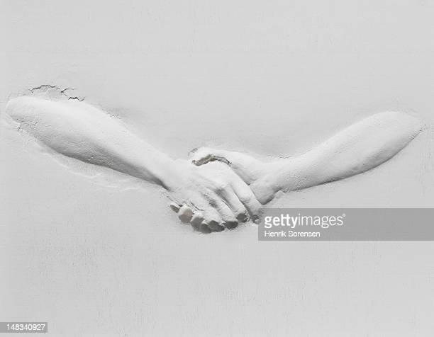 relief of handshake - rappresentazione umana foto e immagini stock