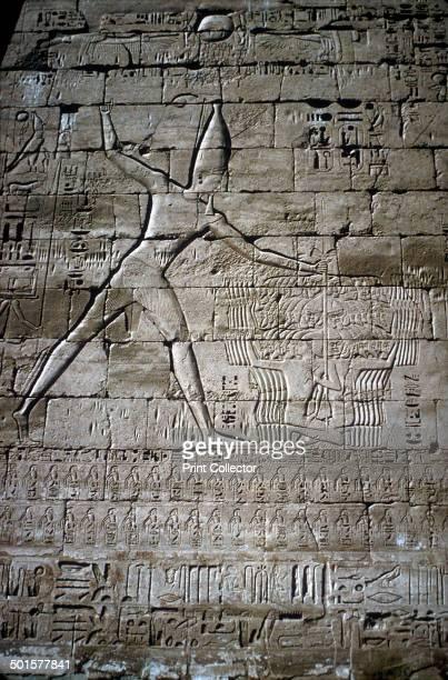Relief of Rameses III smiting his enemies before the gods, Mortuary Temple of Rameses III, Medinat Habu, Luxor, Egypt, c12th century BC.