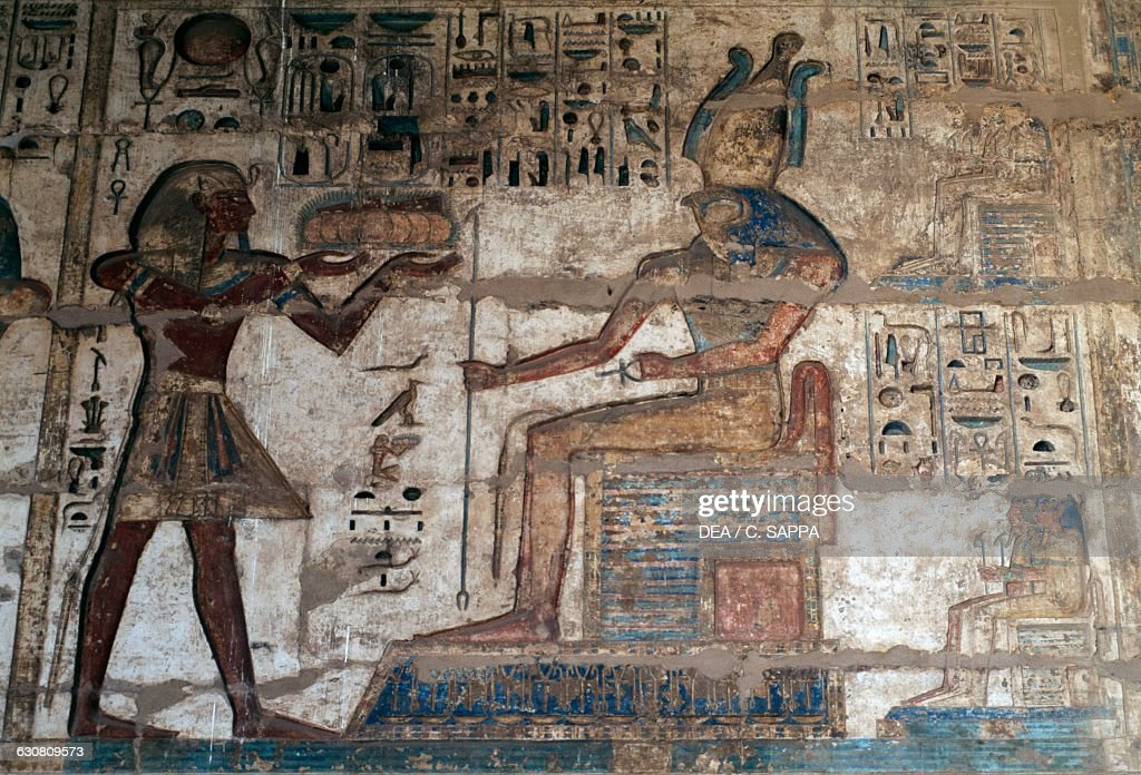 Relief of Ramesses III making offerings to Horus seated on a