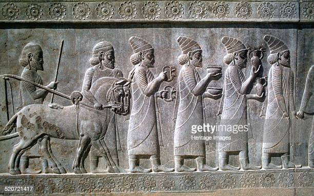 Relief of Syrians or Lydians the Apadana Persepolis Iran The capital of Achaemenid Persia Persepolis was predominantly built during the reigns of the...