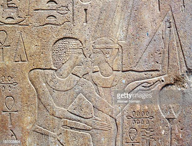 Relief on a block from the Red Chapel of Hatshepsut which was demolished by her successor Tuthmosis III Hatshepsut and Amun in the form of the...