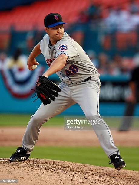 Relief pitcher Aaron Heilman of the New York Mets pitches against the Florida Marlins on opening day at Dolphin Stadium on March 31 2008 in Miami...