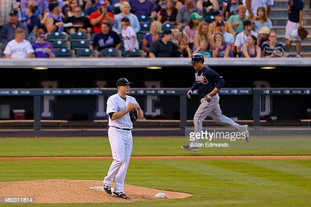 Relief pitcher Aaron Laffey of the Colorado Rockies looks towards the scoreboard after giving up a threerun home run to Kelly Johnson of the Atlanta...