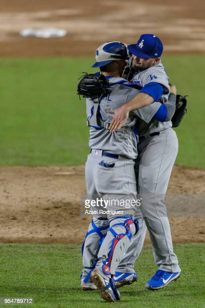 Relief pitcher Adam Liberatore of Los Angeles Dodgers celebrates with teammate catcher Yasmani Grandal after winning the MLB game against the San...