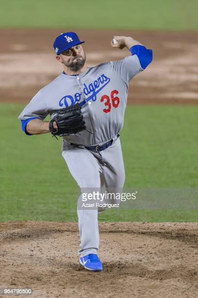 Relief pitcher Adam Liberatore of Los Angeles Dodgers pitches in the 9th inning during the MLB game against the San Diego Padres at Estadio de...