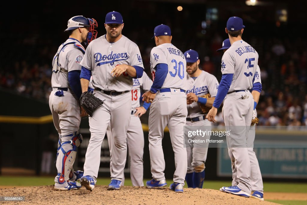 Relief pitcher Adam Liberatore #36 of the Los Angeles Dodgers is removed by manager Dave Roberts #30 during the seventh inning of the MLB game against the Arizona Diamondbacks at Chase Field on May 1, 2018 in Phoenix, Arizona.