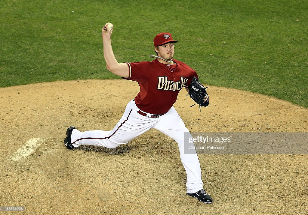 Relief pitcher Addison Reed #43 of the Arizona Diamondbacks pitches against the Colorado Rockies during the MLB game at Chase Field on April 30, 2014 in Phoenix, Arizona. The Diamodbacks defeated the Rockies 5-4 in 10 innings.