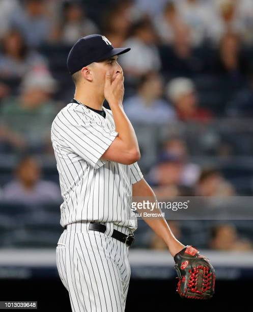 Relief pitcher AJ Cole of the New York Yankees reacts after giving up a run during the 8th inning of an MLB baseball game against the Baltimore...