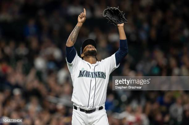 Relief pitcher Alex Colome of the Seattle Mariners reacts after pitching the eighth inning of a game against the Texas Rangers at Safeco Field on...