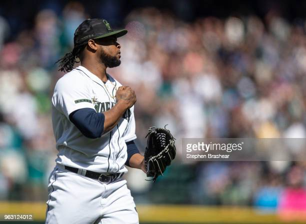 Relief pitcher Alex Colome of the Seattle Mariners reacts after the final out of a game against the Minnesota Twins at Safeco Field on May 27 2018 in...